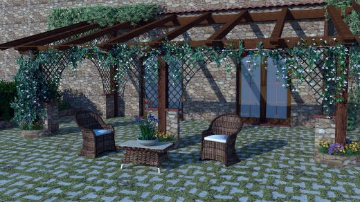 salon de jardin installé sous une pergola